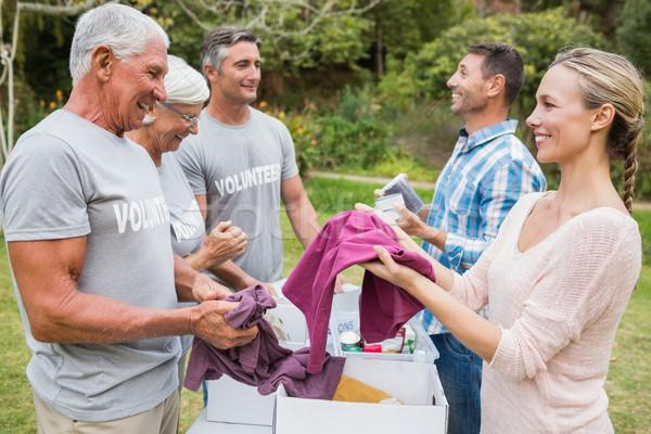 5859646_stock-photo-happy-volunteer-family-separating-donations-stuffs