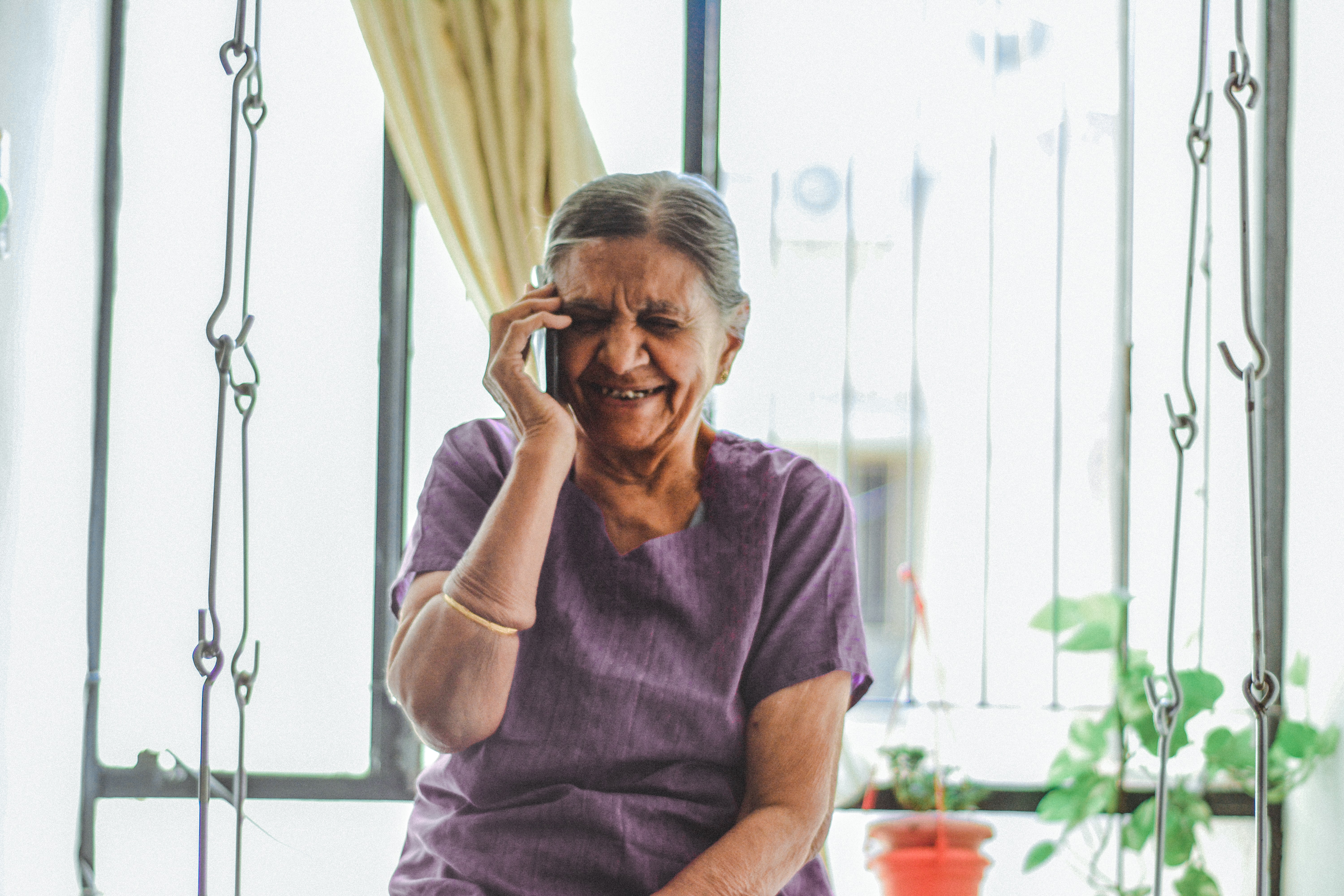 caregiver talking on phone support call